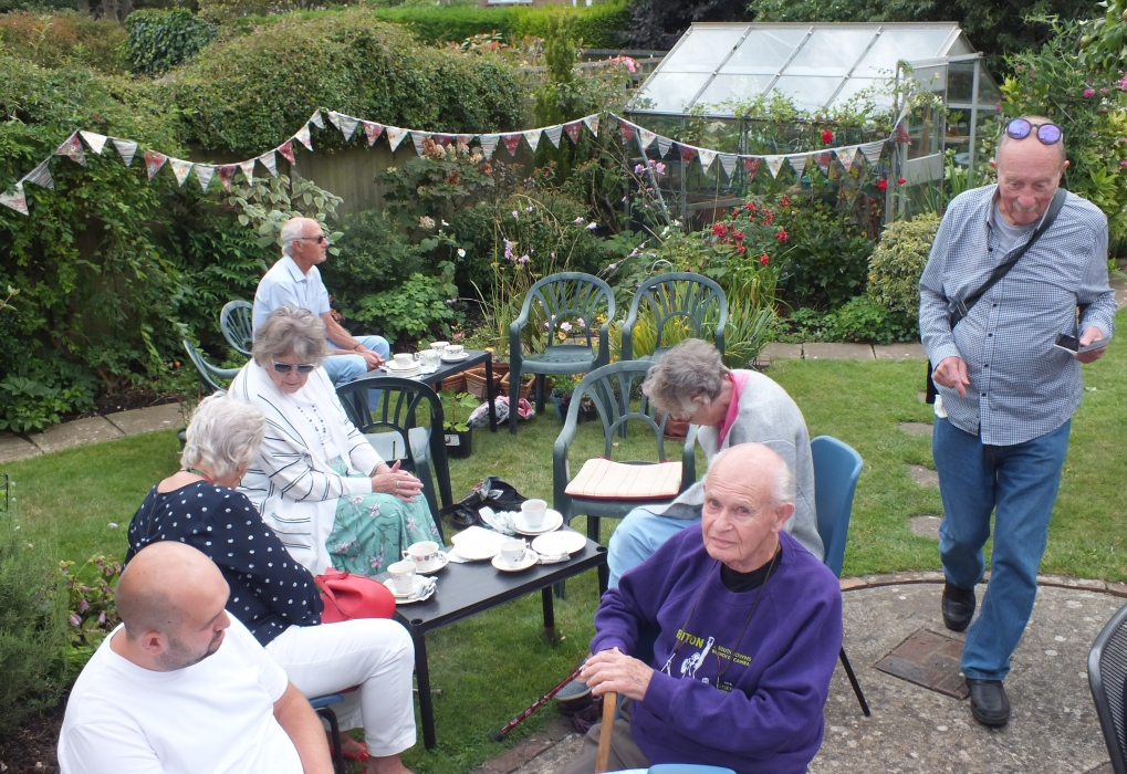 Enjoying the garden 60th Anniversay tea party
